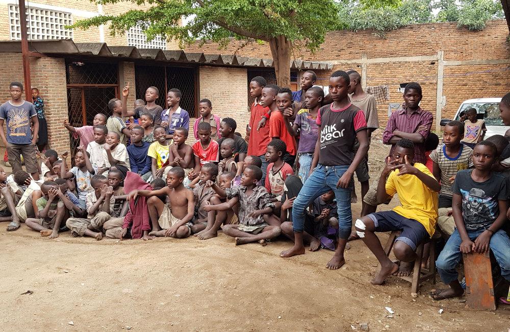 Children at the Centre d'Encadrement et de Réinsertion des Enfants Soleil in Bujumbura get a Christmas visit from staff of OSESG-B, 10 December 2018. UN Photo/Napoleon Viban
